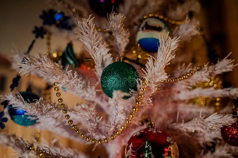Toys on the Christmas tree for the new year. Christmas toys and a black cat. New year. Beautiful holiday royalty free stock images