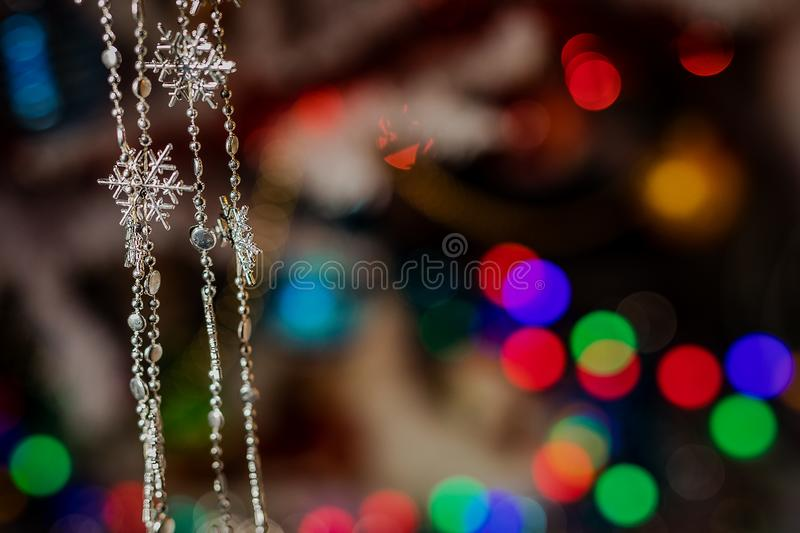 Toys on the Christmas tree for the new year. Christmas toys and a black cat. New year. Beautiful holiday stock photography