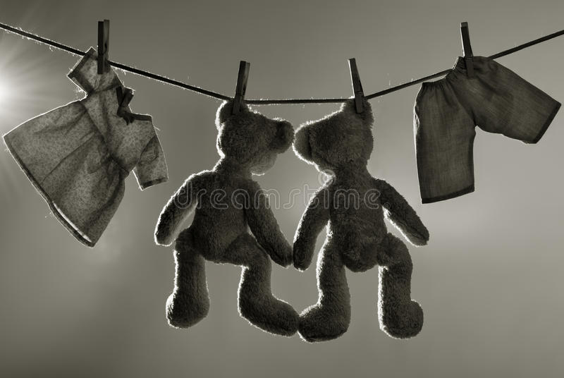 Toys on clothes line stock image