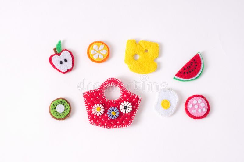 Toys in the form of food and fruits hand made of felt on a white royalty free stock image