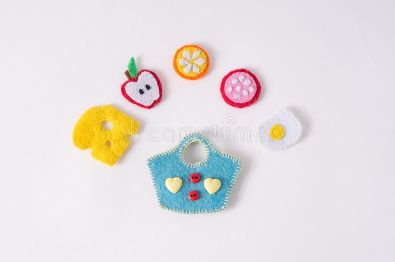 Toys in the form of food and fruits hand made of felt on a white royalty free stock images