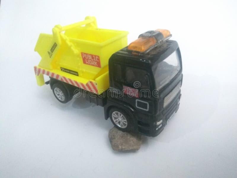 Toys garbage car yellow color white background stock photos