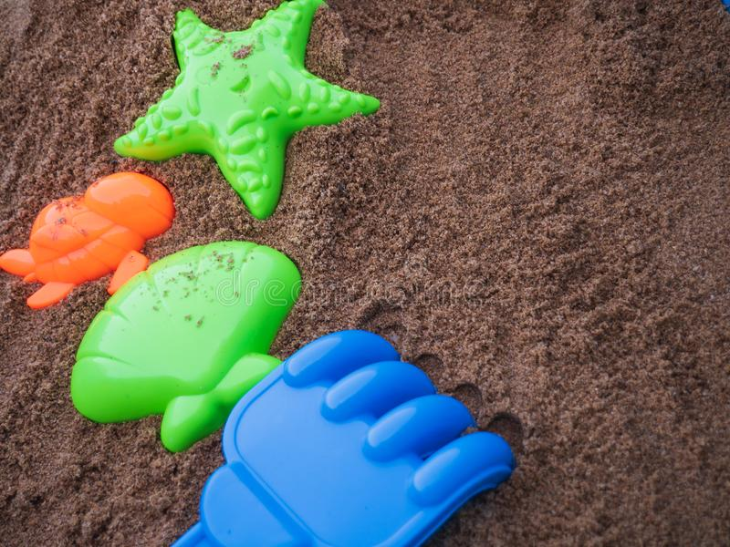 Toys for kid playing with sand background. royalty free stock images