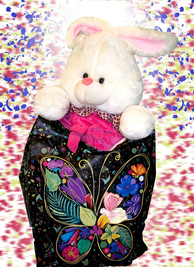 Toys for kids.the little rabbit is ready to be offered a gift stock photography