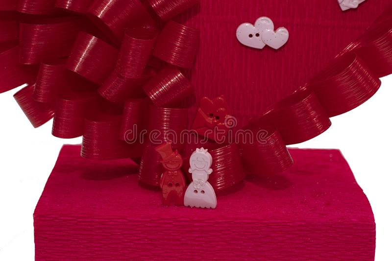 Toys for men and women near the red heart. Love, family, Valentine`s holiday, wedding. Family figurines close up. Holiday card fo. R the wedding and Valentine`s royalty free stock photos