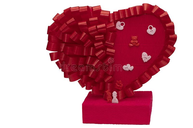 Toys for men and women next to a big red heart on a white background. Family figurines close up. Holiday card for the wedding and. Valentine`s Day stock photography