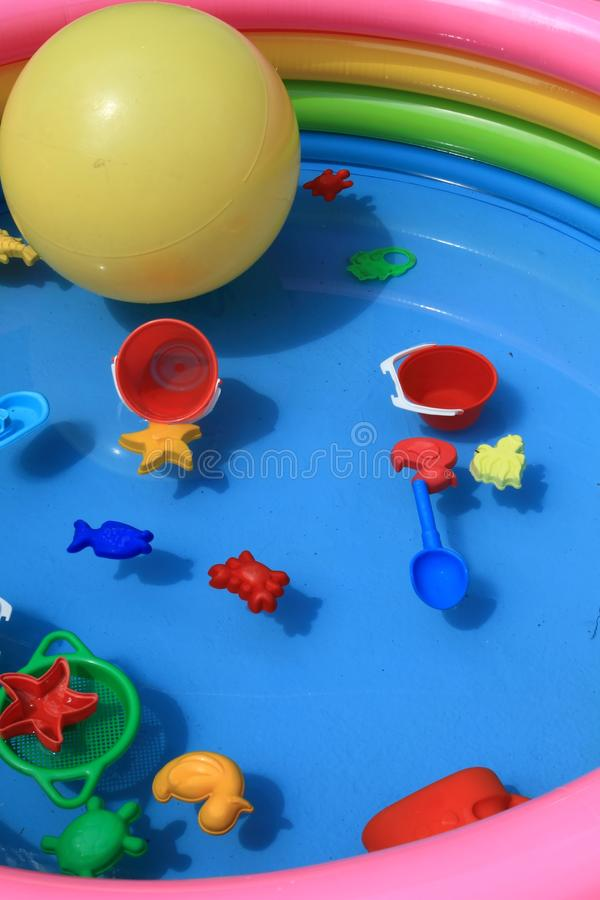 Toys in a pool full of water. Pool full of water and toys royalty free stock images