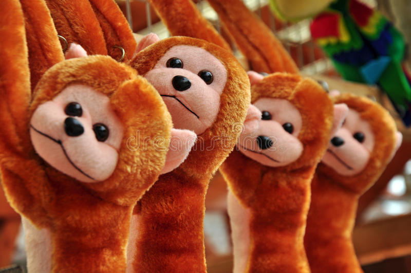 Toys on sale. Stuffed toys, monkey animals on sale royalty free stock images