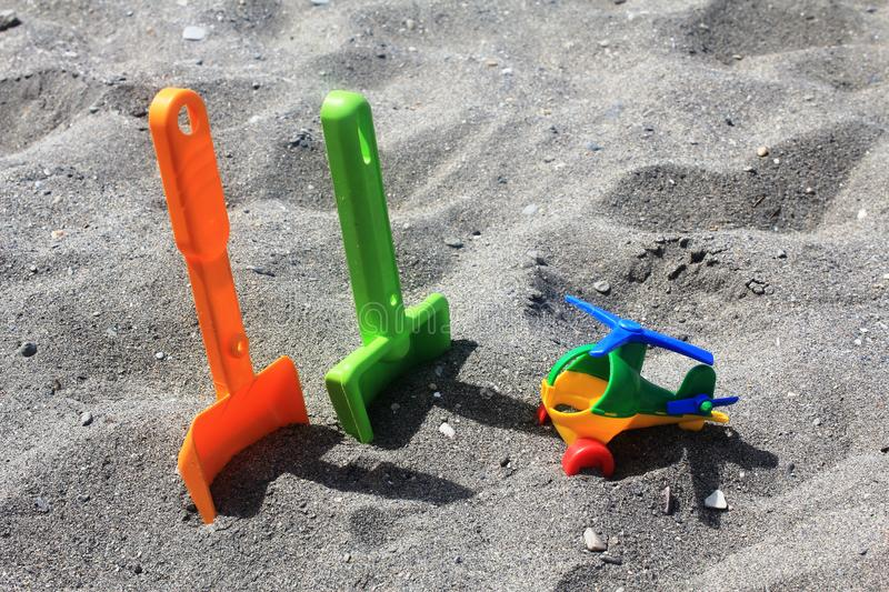 Toys on the sand of the beach in Spain royalty free stock photos