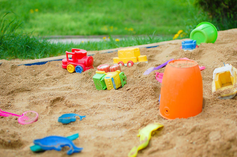 Toys in the sand royalty free stock photo