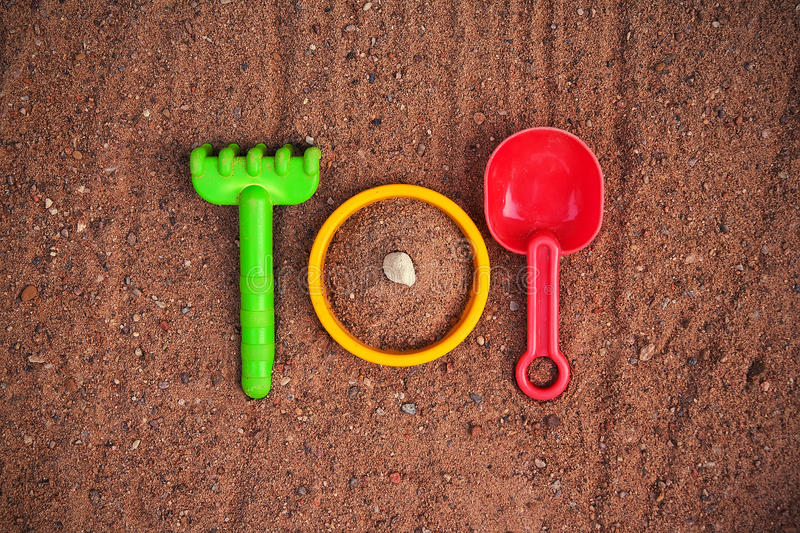 Download Toys in a Sandbox stock photo. Image of cutlery, rake - 25176704