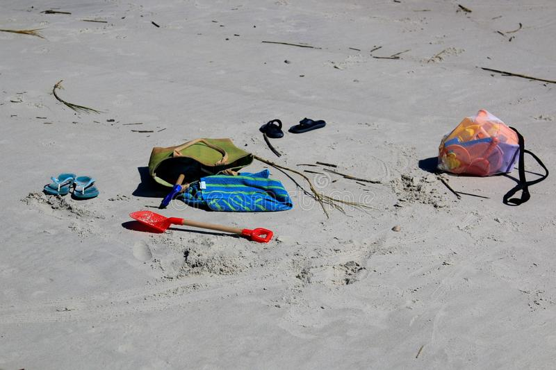 Toys on a sandy beach waiting for their owner stock photo