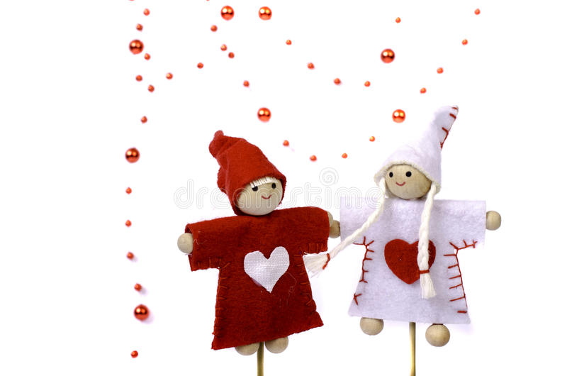 Toys on a stick, beads and two hearts. royalty free stock photo