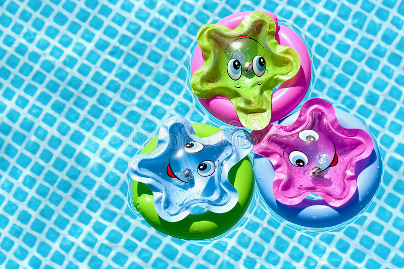 Toys in the swimming pool royalty free stock image