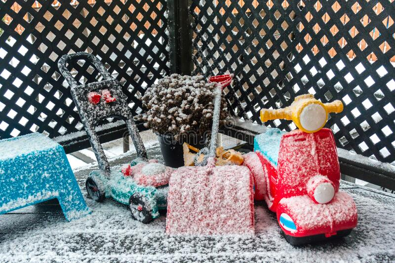 Toys under snow stock photo
