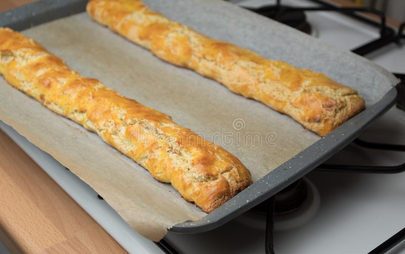Tozetti / Cantucci Tray. Tray of home baked Italian tozzetti/cantucci biscuit before slicing, on top of cooker royalty free stock photos