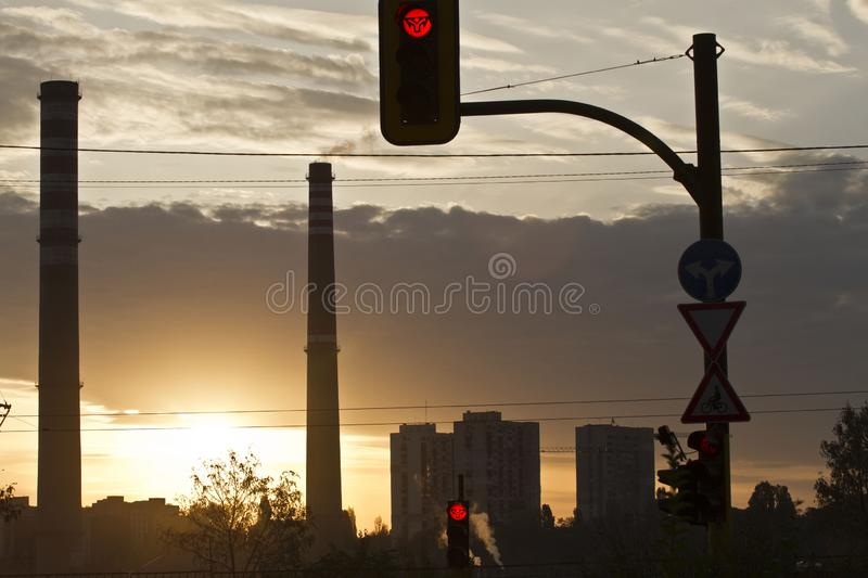 TPP thermal power plant on a sunrise. Refinery with smokestacks. Smoke from factory pollutes the environment. High red and white t stock images