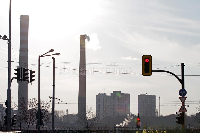 TPP thermal power plant on a sunrise. Refinery with smokestacks. Smoke from factory pollutes the environment stock photos