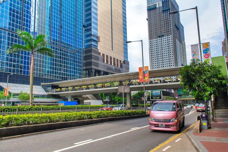 Tráfico y vida de ciudad en Hong Kong Hong Kong es una de las áreas pobladas del mundo foto de archivo