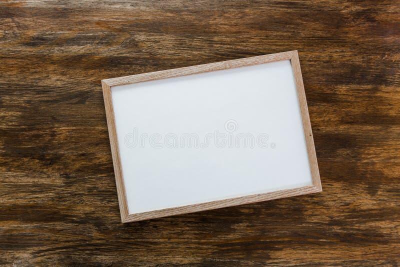 Träbakgrund för fyrkantig ramaffischåtlöje royaltyfri bild