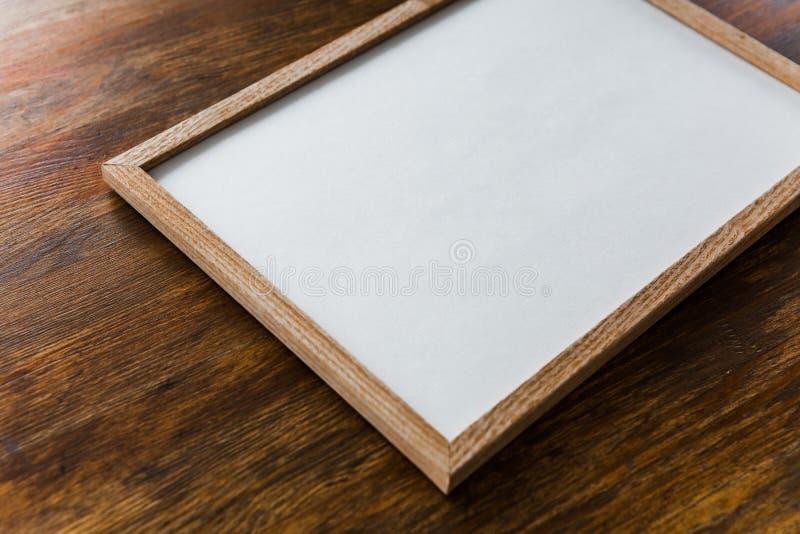 Träbakgrund för fyrkantig ramaffischåtlöje royaltyfri foto