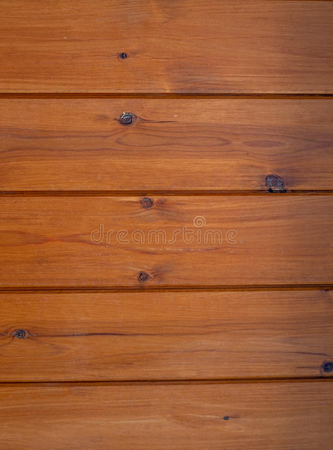 Träbakgrund i bruna signaler royaltyfria bilder