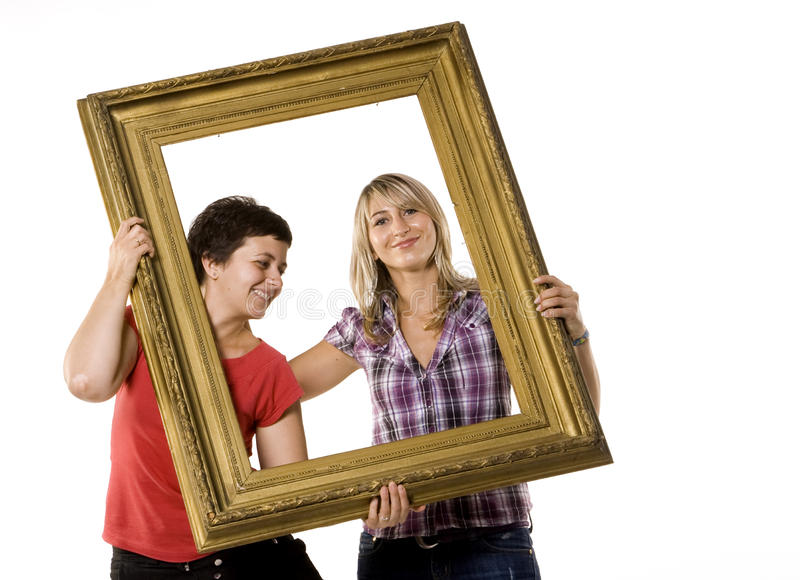 träbarn för ramholdingkvinnor royaltyfri foto