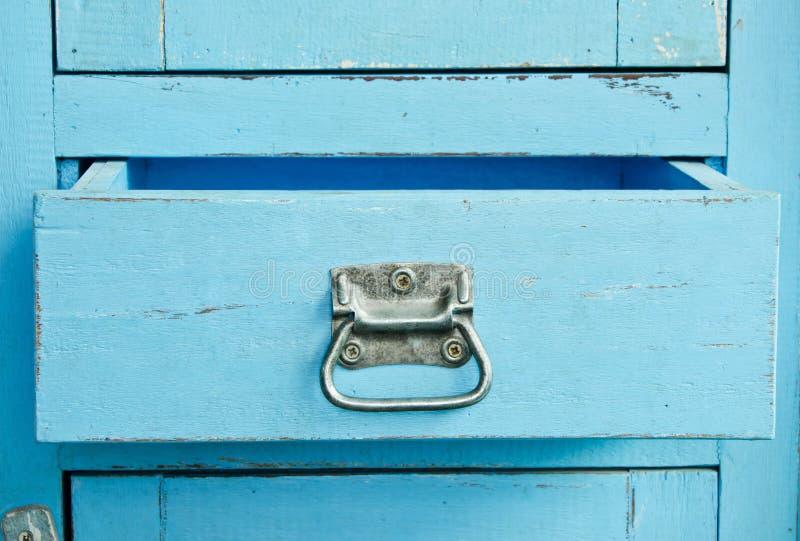 Träblått kabinett fotografering för bildbyråer