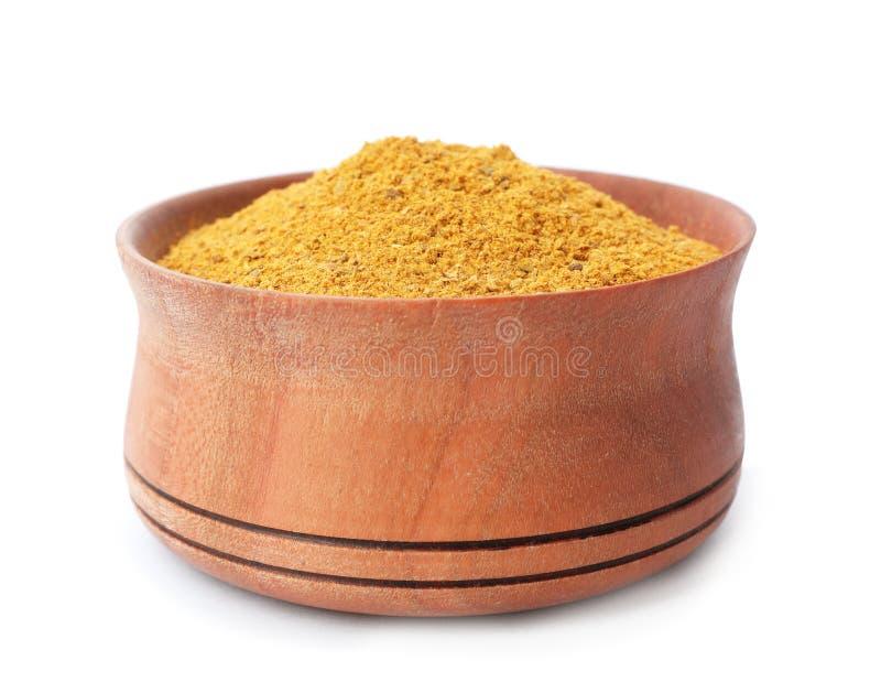 Träbunke med curry royaltyfri foto