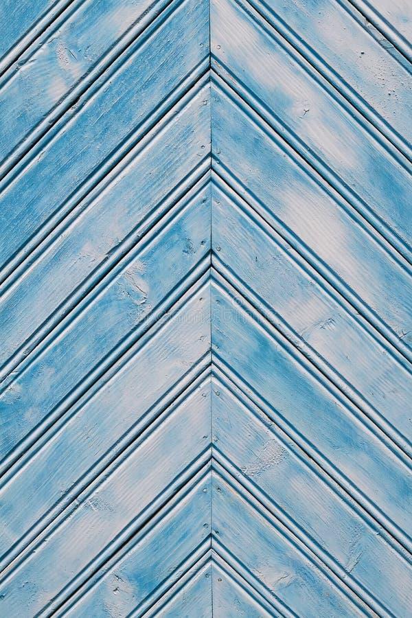 Trägammal blå bakgrund, fiskbensmönster royaltyfri fotografi