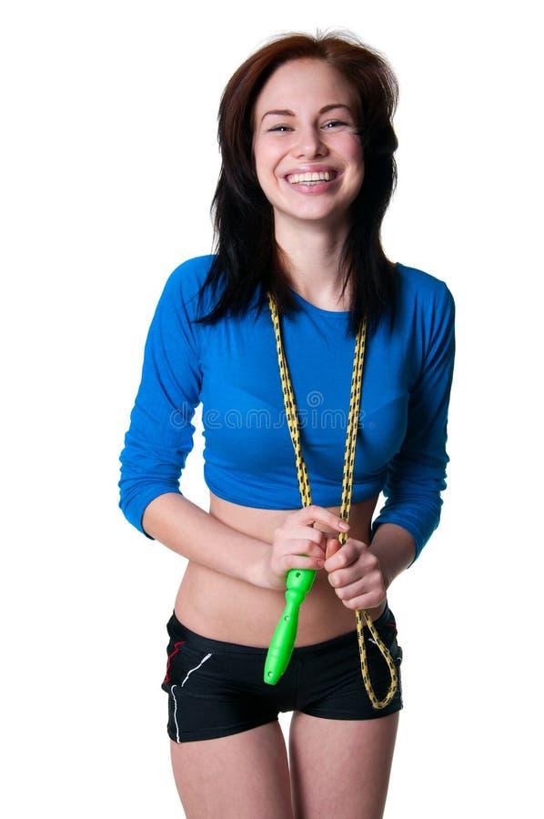 Trägt Mädchen mit Springseil zur Schau lizenzfreies stockbild
