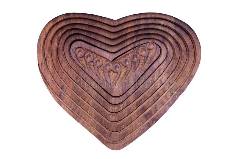 Trähjärtabakgrund Closeup av handgjord trähjärta som isoleras på en vit bakgrund royaltyfria foton