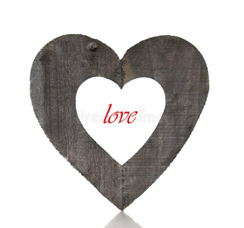 Trähjärtaform och röd förälskelse royaltyfri foto