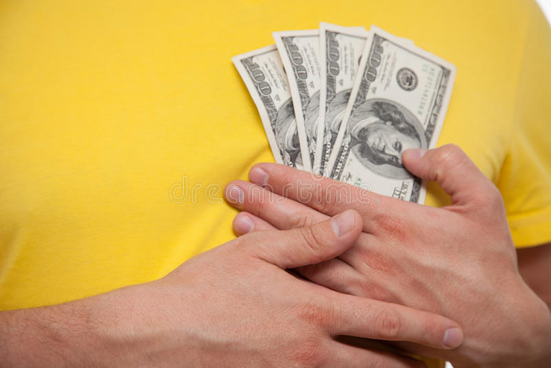 Trängande dollar för man vid bröstkorgen royaltyfria foton