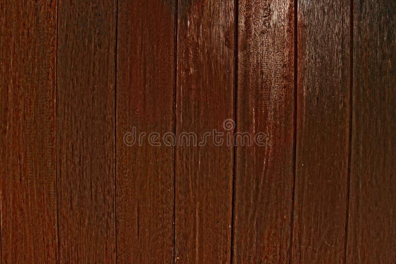 Träplankaväggen texturerar gammal rödbrun skuggabakgrund arkivfoton