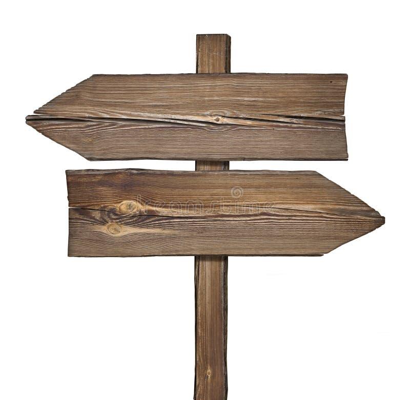 Träriktningstecken med två pilar i motsatta riktningar arkivbild