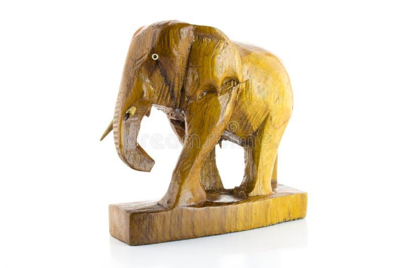 Träsnidit brutet elefantbete arkivfoton