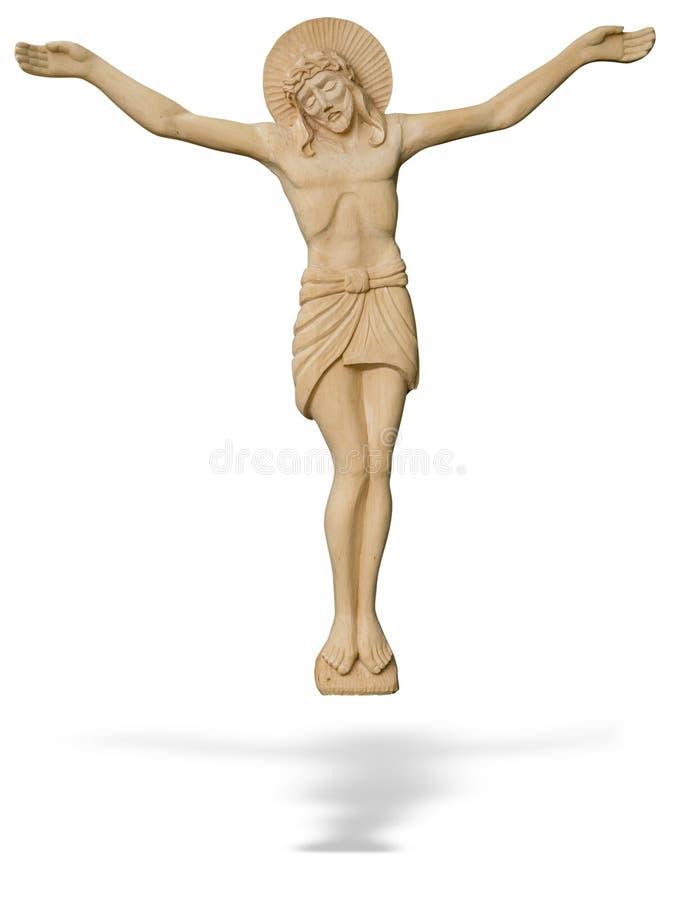 Trästaty av den korsfäste Jesus Christ som isoleras över vit royaltyfri bild