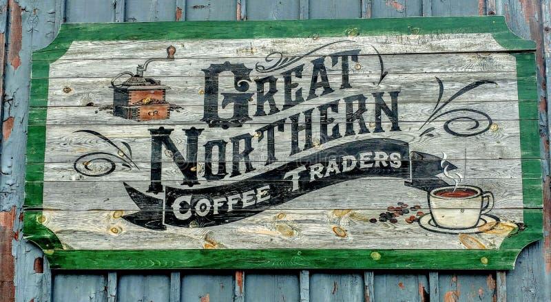 Trätecken för stora nordliga kaffeaffärsmän arkivfoton