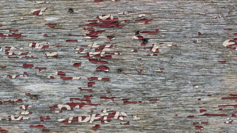 Trätecken med försämras målarfärg arkivfoto