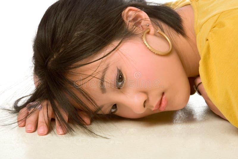 Träumerische chinesische Frau stockbild