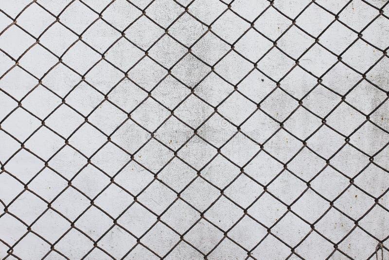 Tråd för ingrepp för metall för bakgrund för rastercell gammal rostig arkivfoto