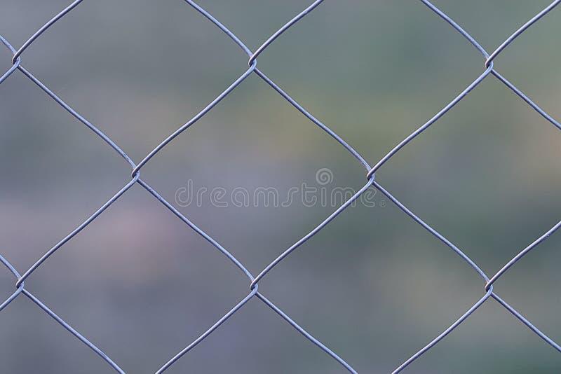 Trådmetall som förtjänar staketet arkivfoton