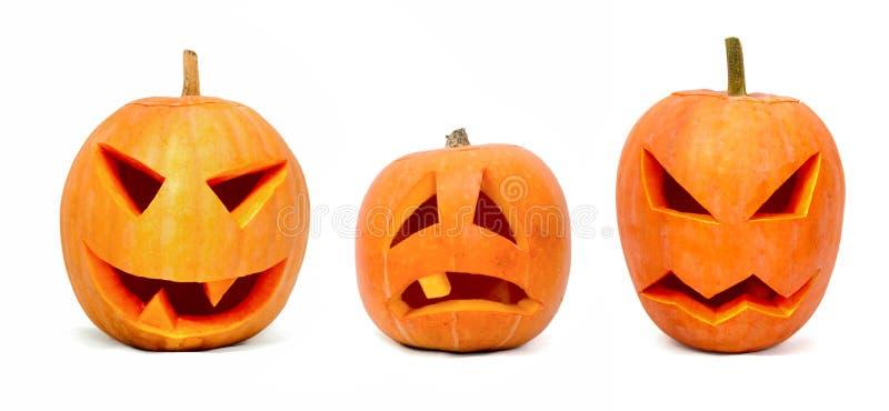 Três abóboras emocionais de Halloween foto de stock