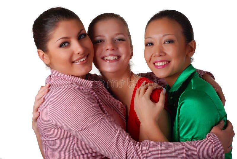 Três amigos felizes foto de stock