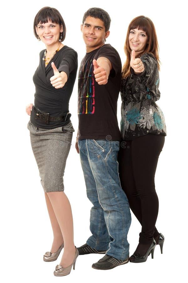 Três Amigos Felizes Com Polegares Acima Imagens de Stock