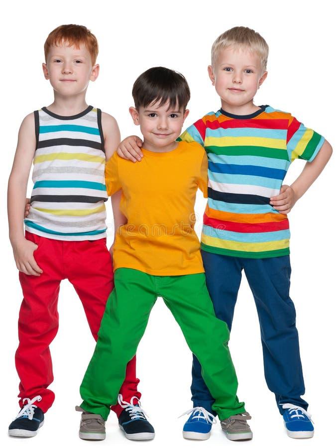 Três amigos pequenos de sorriso foto de stock royalty free