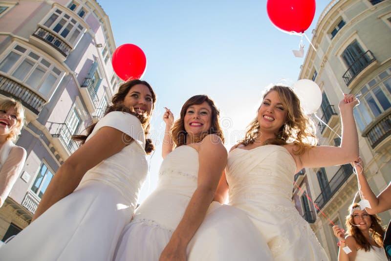 Três amigos vestidos como noivas foto de stock royalty free