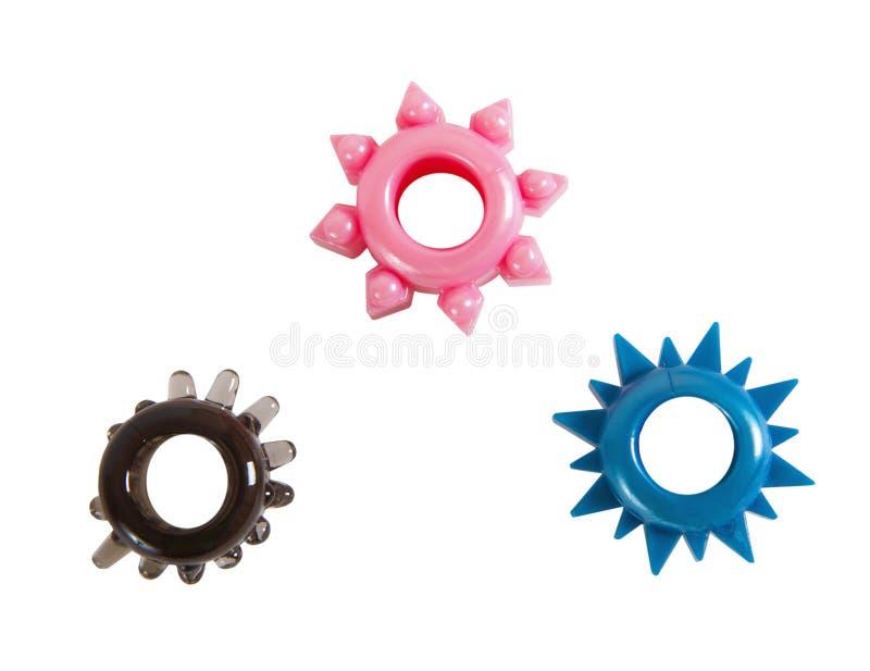 Três anéis coloridos para a ereção do pênis fotografia de stock