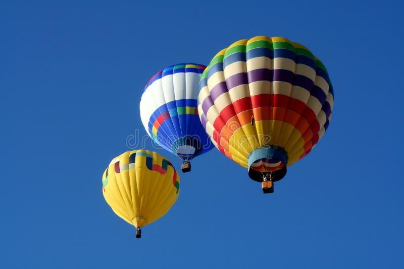 Três balões de ar quente imagem de stock
